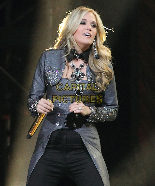 CARRIE UNDERWOOD.Carrie Underwood performs on her Play On Tour, 1st Mariner Arena, Baltimore, Maryland, USA..November 16th, 2010.**Editorial Only!**.stage concert live gig performance music gig half length black jeans denim grey gray long coat beads beaded  .CAP/EAST/EML.©EML/Eastman/Capital Pictures.