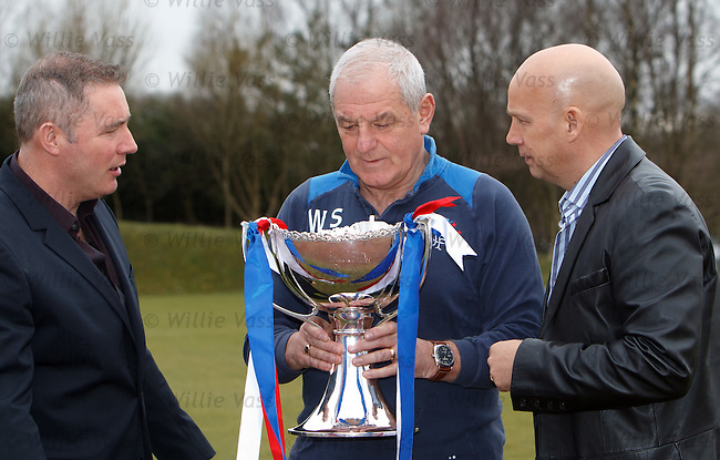 Walter Smith staring into the Scottish League Cup and reflectiong on a victory over Celtic to claim the first of the silverware this season