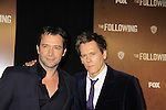 """Guiding Light's Kevin Bacon """"Tim Werner"""" and (Search For Tomorrow) FBI agent """"Ryan Hardy"""" (L) and James Purefoy (serial Killer) chased by  """"Ryan"""" both star in """"The Following"""" a new tv series on Mondays, which held its world premiere on January 19, 2013 at the New York Public Library, New York City, New York. (Photo by Sue Coflin/Max Photos)"""