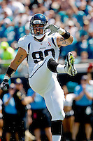 Sept 11, 2011:   Jacksonville Jaguars linebacker Matt Roth (90) celebrates after sacking quarterback Matt Hasselbeck (not pictured) during first half action between the Jacksonville Jaguars and the Tennessee Titans at EverBank Field in Jacksonville, Florida.   ........