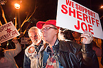 """Nov. 30, 2009 -- PHOENIX, AZ: A supporter of Sheriff Joe Arpaio shouts at anti sheriff protestors at the Walter Cronkite School of Journalism and Mass Communication at Arizona State University in Phoenix, AZ. The event was billed as a """"Meet the Press"""" type interview with controversial Maricopa County Sheriff Joe Arpaio. Arpaio was questioned by three members of the faculty, all former journalists. About 3/4 of the way through the one hour program, protestors opposed to Sheriff started singing and effectively shut down the program forcing the sheriff to leave early. Several hundred protestors, both opposed to and supporting the sheriff, picketed the front of the school during the program.   Photo by Jack Kurtz"""