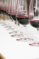Glasses of red Saint Joseph or Cornas with glasses marked with Saint Joseph, in a line for tasting. Against a white background.  Domaine Eric et Joel Joël Durand, Ardeche, Ardèche, France, Europe