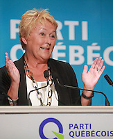 "PQ leader and Quebec Premier Pauline Marois gestures as she speaks at the ""Universite d'ete des jeunes du Parti Quebecois"" event in Quebec City, Sunday August 25, 2013."