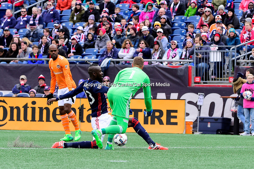 Saturday, April 8, 2017: New England Revolution forward Kei Kamara (23) attempts to block the kick from Houston Dynamo goalkeeper Tyler Deric (1) during the MLS game between Houston Dynamo and the New England Revolution held at Gillette Stadium in Foxborough Massachusetts. New England defeats Houston 2-0. Eric Canha/CSM