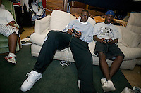 Eric Boateng plays basketball on a video game in a dorm room at St Andrews High School in Middletown, DE, United States, 19 April 2005.