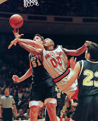 HIGH SCHOOL 4A BASKETBALL PLAYOFFS.        HOUCHRON CAPTION (03/15/1998):  The only way Highland Park players such as Chris Young, left, could stop the likes of Waltrip's Clementa Simmons was by fouling.