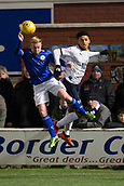 29th January 2019, Palmerston Park, Dumfries, Scotland; Scottish Cup football, 4th round replay, Queen of the South versus Dundee; Nicky Low of Queen of the South competes in the air with Nathan Ralph of Dundee