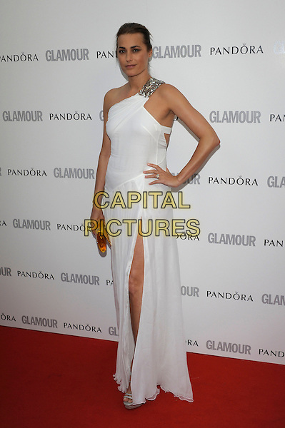 Yasmin Le Bon.Women Of The Year 2012 - Glamour Awards, Berkeley Square, London, England..29th May 2012.full length white dress one shoulder slit split hand on hip.CAP/PL.©Phil Loftus/Capital Pictures.