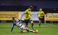 Daniel Leadbitter  of Bristol Rovers tackles Callum O'Dowda of Oxford United during the Sky Bet League 2 match between Oxford United and Bristol Rovers at the Kassam Stadium, Oxford, England on 17 January 2016. Photo by Andy Rowland / PRiME Media Images.