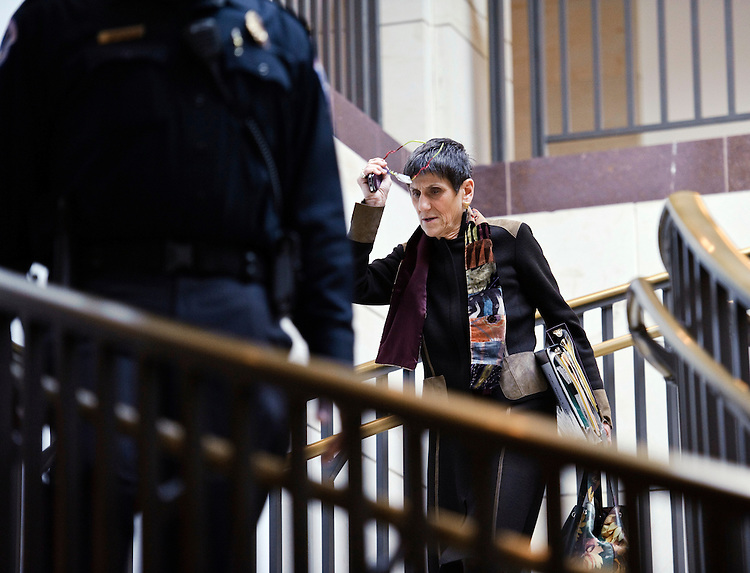 WASHINGTON, DC- Jan. 12: Rep. Rosa DeLauro, D-Conn., follows a U.S. Capitol Police officer (who was not escorting her) toward Democratic meetings for the steering committee to decide committee posts, and a security briefing for members in the wake of the shooting in Tuscon, Ariz., on Jan. 8 that killed six and injured 14, including Giffords, D-Ariz., who is recovering after being shot in the head. Security presence at the Capitol is ramped up since the shooting. (Photo by Scott J. Ferrell/Congressional Quarterly)