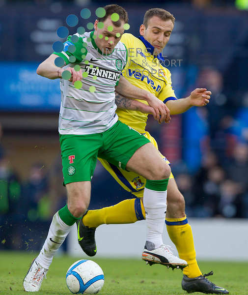 Anthony stokes takes on liam Kelly during the Scottish Communities League Cup Final - Celtic v Kilmarnock FC at Hampdem park, Glasgow..Picture: Universal News And Sport (Europe). 16 March 2012. www.unpixs.com..