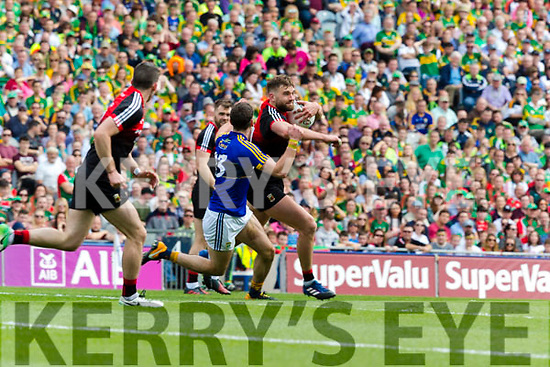 Paul Geaney Kerry in action against Aidan O'Shea Mayo in the All Ireland Semi Final Replay in Croke Park on Saturday.