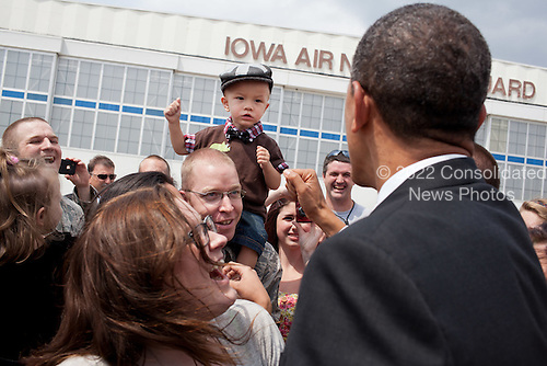 United States President Barack Obama greets people upon arrival at Des Moines International Airport in Des Moines, Iowa, May 24, 2012. .Mandatory Credit: Pete Souza - White House via CNP