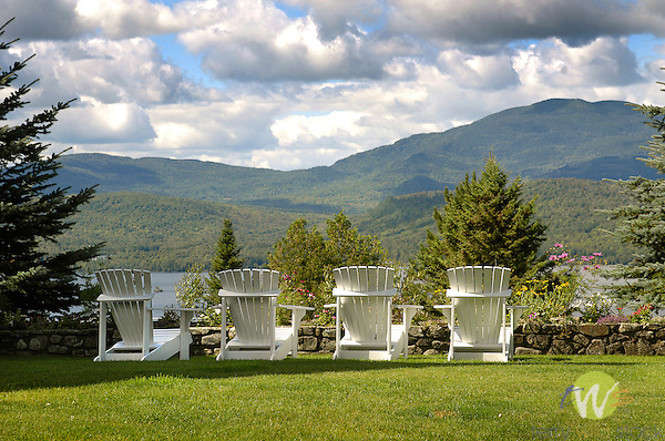 Blair Hill Inn patio with Adirondack chairs and view of Moosehead Lake.