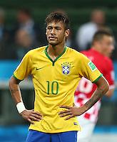 Neymar of Brazil shows a look of dejection