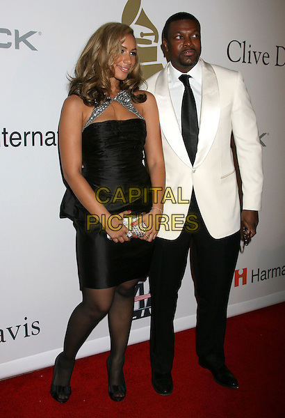 LEONA LEWIS & GUEST.51st Annual GRAMMY Awards - Salute To Icons: Clive Davis Pre-Grammy Gala held at the Beverly Hilton Hotel, Beverly Hills, California, USA..February 7th, 2009.full length black dress white suit jacket trousers silver clutch bag .CAP/ADM/MJ.©Michael Jade/AdMedia/Capital Pictures.