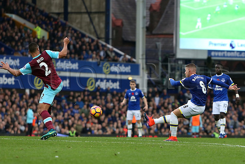 30.10.2016. Goodison Park, Liverpool, England. Premier League Football. Everton versus West Ham United. Winston Reid of West Ham United stretches to block the shot of Ross Barkley of Everton