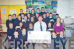 The communion Class of Ardfert National School who with presented to Sean Scally of Enable Ireland a cheque of EUR616 on Wednesday> Front l-r: Jamie O'Hara,Nessa McGarty,Emily Barrett and Sally O'Mahony. Seated l-r: Noel Lenihan,Riadh Malik,Seasmus O'Halloran, Sean Scally(Enable Ireland),Kate McCarthy and Marie O'Connell(Teacher). 3rd row l-r: Emma Lawlor,Kate O'Sullivan,Lauren O'Grady,Killian Dalton,Clodagh O'Hara,Katie Daly,Clodagh Thompson,Orla O'Riordan,Norette Casey,Diarmuid O'Connor and Philip McCarthy. Back l-r: Luke Turley,Muireann O'Mahony,Orla Hussey,John Crowley,Adrian Nolan and Fiacha Ennis..   Copyright Kerry's Eye 2008