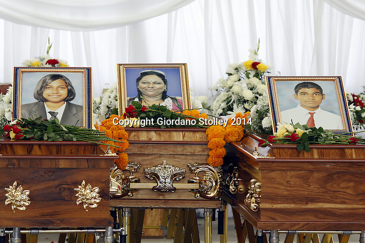 DURBAN - 4 March 2014 - The photos of Melarisa Kandasamy, 18, (left picture), Mala Kandasamy and Megandren Kandasamy, 17, are displayed above their coffins at their funeral in Chatsworth. Rajan Kandasamy, Mala's husband and the father of her two children, is lleged to have beaten them to death in their home using a gada --  a traditional Indian mace carried by the Hindu god Hanuman Picture: Allied Picture Press/APP