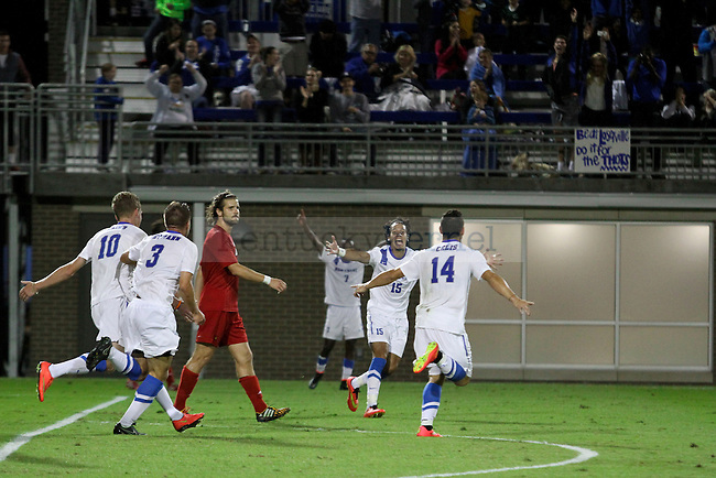 Kentucky junior Bryan Celis celebrates with his teammates after scoring a goal during the Kentucky men's soccer match against Louisville at the Wendell and Vickie Bell Soccer Complex in Lexington, Ky., on Tuesday, September 23, 2014. Photo by Jonathan Krueger | Staff
