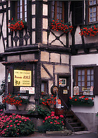 France, Alsace, Dambach-la-Ville, Bas-Rhin, Europe, wine region, Entrance to a Wine House decorated with flowers in the village of Dambach-la-Ville in the wine region of Alsace.