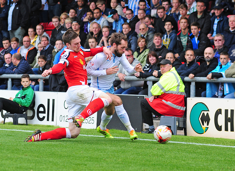 Coventry City's James O'Brien is tackled by Crewe Alexandra's Matt Tootle<br /> <br /> Photographer Chris Vaughan/CameraSport<br /> <br /> Football - The Football League Sky Bet League One - Crewe Alexandra v Coventry City - Saturday 11th October 2014 - Alexandra Stadium - Crewe<br /> <br /> &copy; CameraSport - 43 Linden Ave. Countesthorpe. Leicester. England. LE8 5PG - Tel: +44 (0) 116 277 4147 - admin@camerasport.com - www.camerasport.com