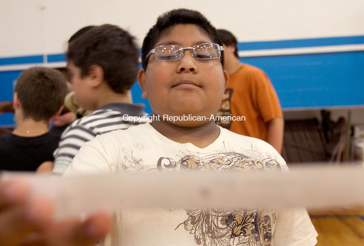 NAUGATUCK, CT. 07 June 2011-060711SV02--Sebastian Hernandez Garcia, 11, of Naugatuck does a blind spot vision test during a vision exhibition that a Naugatuck High School honors anatomy class presented to fifth-graders at Cross Street Intermediate School in Naugatuck Tuesday. The high school students set up stations to teach a hands-on lesson explaining the vision process to the younger students.<br /> Steven Valenti Republican-American