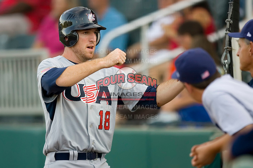 Ike Davis #18 of Team USA fist bumps with teammates after scoring a run in the first inning against Team Canada at the USA Baseball National Training Center, September 4, 2009 in Cary, North Carolina.  (Photo by Brian Westerholt / Four Seam Images)