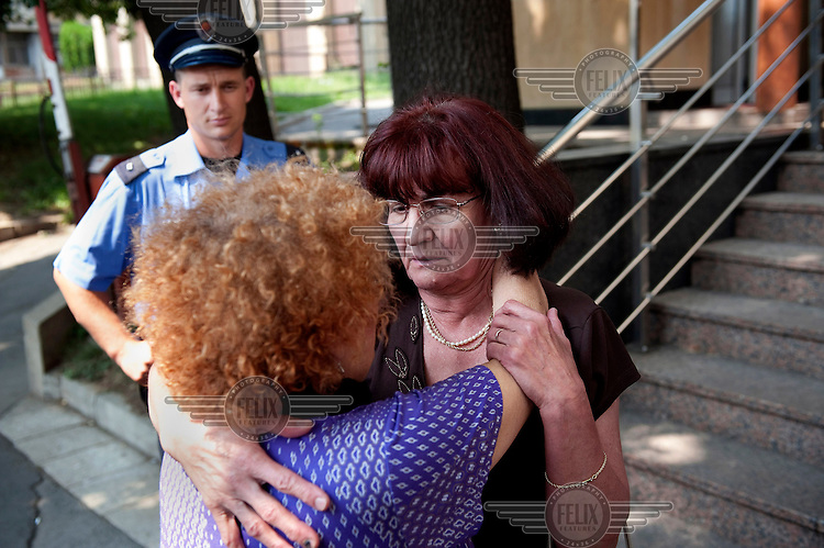 A supporter greets Bosiljka Mladic as she leaves the special court where her husband is being held. Ratko Mladic has been arrested by Serbian security forces on charges of genocide, crimes against humanity and war crimes. He is one of the most sought after suspects from the Bosnia conflict and is facing extradition.