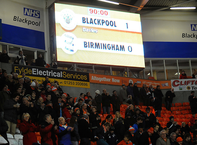 Blackpool fans applaud their side at the final whistle<br /> <br /> Photographer Kevin Barnes/CameraSport<br /> <br /> Football - The Football League Sky Bet Championship - Blackpool v Birmingham City - Saturday 6th December 2014 - Bloomfield Road - Blackpool<br /> <br /> &copy; CameraSport - 43 Linden Ave. Countesthorpe. Leicester. England. LE8 5PG - Tel: +44 (0) 116 277 4147 - admin@camerasport.com - www.camerasport.com