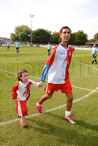 07.09.2014.  Poole, England. Charity match in aid of MND sufferer Andrew Culliford. Andrew Culliford and his daughter Isla.