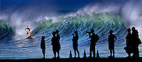 Spectators gather to watch the excitement of epic wave surfing on the South Shore of Oahu.