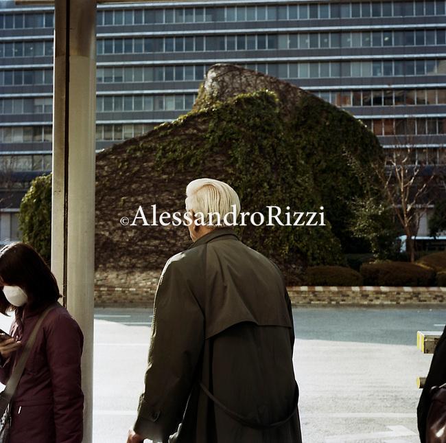 Back side of a man walking near a girl