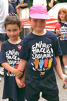 Friends age 6 holding hands in Grand Old Day Festival Parade.  St Paul  Minnesota USA