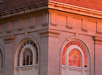 Sunlight reflects in the window on a building in the historical court square in downtown Charlottesville, Va. Photo/Andrew Shurtleff