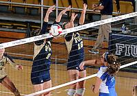 Florida International University women's volleyball player Silvia Carli (9) plays against Florida Gulf Coast University.  FIU won the match 3-0 on November 8, 2011 at Miami, Florida. .