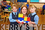 Twins Amy and Brid O'Shea pictured with their teacher Mary Hennessy on their first day of school at presentation primary, Tralee on Thursday.