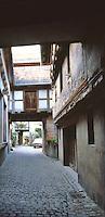 Riquewihr: Narrow street of brick.