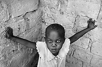A young orphaned girl in Kitwe, Zambia on May 13, 2001. She is among the more than 13 million African children who have been orphaned by the the AIDS pandemic. Worldwide, more than 20 million people have died since the first cases of AIDS were identified in 1981.