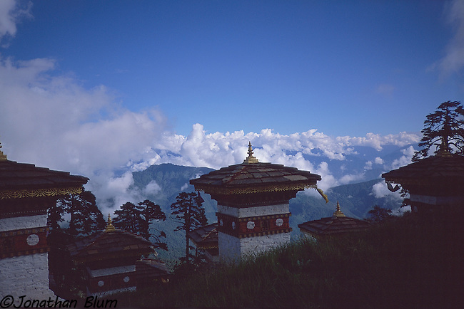 Stupas located in a high pass.  This site was created as a tribute by one of the queens of Bhutan.