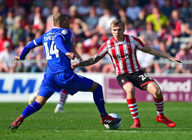 Lincoln City's Harry Anderson vies for possession with Tranmere Rovers' Jake Caprice<br /> <br /> Photographer Andrew Vaughan/CameraSport<br /> <br /> The EFL Sky Bet League Two - Lincoln City v Tranmere Rovers - Monday 22nd April 2019 - Sincil Bank - Lincoln<br /> <br /> World Copyright © 2019 CameraSport. All rights reserved. 43 Linden Ave. Countesthorpe. Leicester. England. LE8 5PG - Tel: +44 (0) 116 277 4147 - admin@camerasport.com - www.camerasport.com