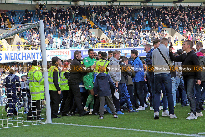 Millwall fans run onto the pitch at the end of the match and congratulate goalkeeper, Jordan Archer, after securing their place in the Play-Off's during Millwall vs Oldham Athletic, Sky Bet League 1 Football at The Den on 30th April 2016