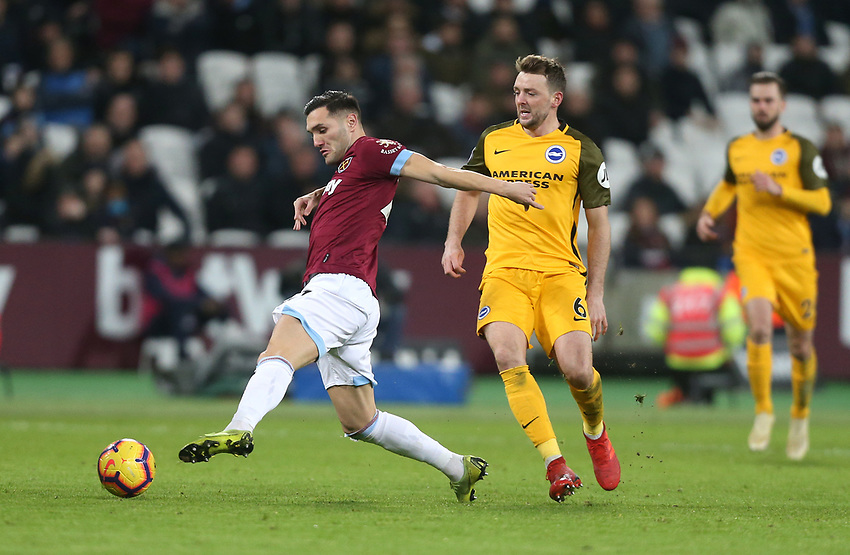 West Ham United's Lucas Perez and Brighton & Hove Albion's Dale Stephens<br /> <br /> Photographer Rob Newell/CameraSport<br /> <br /> The Premier League - West Ham United v Brighton and Hove Albion - Wednesday 2nd January 2019 - London Stadium - London<br /> <br /> World Copyright © 2019 CameraSport. All rights reserved. 43 Linden Ave. Countesthorpe. Leicester. England. LE8 5PG - Tel: +44 (0) 116 277 4147 - admin@camerasport.com - www.camerasport.com