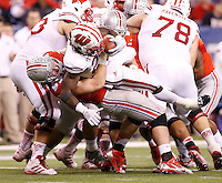 Ohio State Buckeyes defensive lineman Joey Bosa (97) tackles Wisconsin Badgers running back Melvin Gordon (25) during the third quarter of the Big Ten Championship game at Lucas Oil Stadium in Indianapolis on Dec. 6, 2014. (Adam Cairns / The Columbus Dispatch)