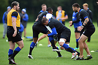Elliott Stooke of Bath Rugby puts in a tackle. Bath Rugby pre-season training session on August 9, 2017 at Farleigh House in Bath, England. Photo by: Patrick Khachfe / Onside Images