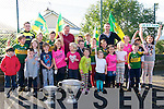 Scoil Dhún Chaoin pupils and teachers welcoming Kerry players Marc Ó Sé and Brian Rael (minors) bringing Sam Maguire and Tom Markham cups to the school on Wednesday.