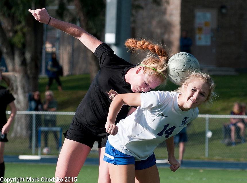 JSerra's Samantha Hobert heads the ball over Santa Margarita's Machaela George in league play.