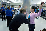 Mirna Vasquez a refugee from El Salvador, is searched by a TSA official in the airport in San Antonio, Texas, on December 2, 2015. She fled El Salvador with her daughter to escape gang-related violence. After requesting political asylum in the United States, they were held for several days by immigration officials and then released, although she wears an ankle monitors. They stayed briefly in a shelter run by the Refugee and Immigrant Center for Education and Legal Services (RAICES) and supported by a coalition of San Antonio churches, then flew to another location in the U.S. while they await final decisions on their asylum petition.