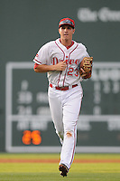 Infielder Nick Natoli (23) of the Greenville Drive runs off the field during a game against the Rome Braves on August 15, 2012, at Fluor Field at the West End in Greenville, South Carolina. Rome won, 6-1. (Tom Priddy/Four Seam Images)