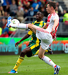 Nederland, Den Haag, 23 september  2012.Seizoen 2012/2013.Eredivisie.Ado Den Haag-Ajax.Derk Boerrigter van Ajax in duel om de bal met Kenneth Omeruo van Ado den Haag..